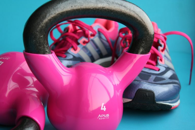 pink kettle bell and sneakers